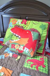 ....At Home in the Cove: Michaels dinosaur room make-over!    Linens from Target. Dinosaur vinyl wall decals from Etsy.