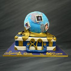 Celebrate the travel bug's birthday with this amazing cake! This was made for Muriel's 80th birthday party and her family wanted to show everyone how much she loves traveling. The bottom tier of this cake is made to look like a navy blue suitcase with gold and white details. The top is a 3D globe with edible images of Muriel tacked on different parts of the world. The countries on the world were of course made out of fondant and decorated with edible images to make it look like a real globe.