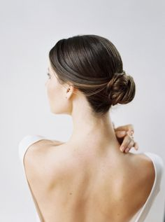 The low bun against this fabulous back is sensuous and lady0like!