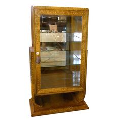 Art Deco Display Curio or Bar Cabinet in Ruhlmann Style | From a unique collection of antique and modern vitrines at https://www.1stdibs.com/furniture/storage-case-pieces/vitrines/