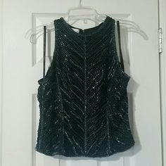 Stunning Sequined Crop Top Stunning sequined tank top that sits a bit above the hips - perfect for a hot night out, theme parties, or bachelorette parties! Very comfortable and chic Lawrence Kazar Tops Crop Tops