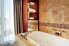 Presidential Suite - Marble Bathroom witih mirror TV, jacuzzi, seperate shower and luxury bath products by Hermès. #hotelpresidentwilson #geneva #luxuryhotel #5starhotel #luxurysuites #PresidentialSuite