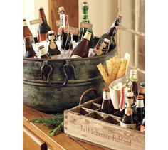 Idea from Pottery Barn: serve beer in old metal bucket. Look for wooden beer crates at antique stores/flea markets.