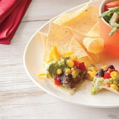 Dig in to this delicious 5 layer dip with corn, refried beans, and guacamole.
