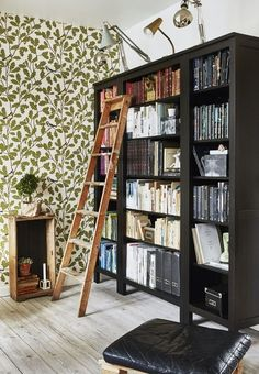 Design a creative and inspirational bookshelf with color coded books. We love the old wooden ladder.