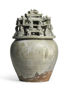 A 'Yue' celadon-glazed funerary jar with seated buddhist figures, Western Jin dynasty
