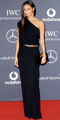 Thandie Newton WHAT SHE WORE At the Laureus World Sports Awards, Newton worked black and gold head-to-toe, including a draped Osman column, tassel earrings and an elongated clutch.