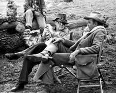 TWO RODE TOGETHER (1960) - Director John Ford with James Stewart on location near Brackettville, Texas - Columbia Pictures.