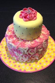 Teen girls birthday cake. Pink strawberry cake with strawberry buttercream icing on bottom. Yellow colored vanilla cake with vanilla fondant on bottom.