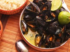 Steamed Mussels With Thai-Style Coconut-Curry Broth | As a testament to the versatility of steamed mussels, this recipe moves to the other side of the world for inspiration. The technique is basically the same, but we make the broth with coconut milk and flavor it with fish sauce, sliced chilies, brown sugar, and homemade curry paste.  #mussels #seafood #thaifood #curry #recipe