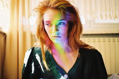 Photo tip: Prisms and colored glass in general make for lovely portraits.    Photo by Lukasz Wierzbowski; via Ignant