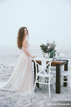 We just adore this photo from our Sea Fog Bridal Shoot in Ponce Inlet! Our White French Country Chairs were a perfect fit! Many thanks to Nato Tuke Photography, Contemporary Calligraphy, Lo Zukowski Calligraphy, and Lola Grace Bridal.