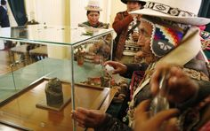 Indigenous Andean spiritual counselors known as Amautas spray alcohol on the case protecting a pre-Columbian relic made of carved stone during its presentation at the presidential palace after it was returned from Switzerland, in La Paz, Bolivia, Monday, November 17, 2014. Bolivia recovered the 2000 year old relic after it had been in Switzerland for 156 years. According to experts, it's a woman representing an Ekeko Andean deity, god of fertility and abundance, from the Pucara culture that…