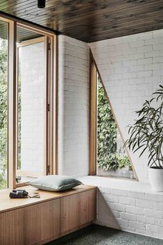 Living Room, Bench, Terrazzo Floor, and Track Lighting The clients were looking to create a calm and comfortable space to retreat within, with moments of privacy and seclusion within the open plan.  Photo 5 of 10 in A Melbourne Home Gains a Gorgeous Glass-Fronted Addition