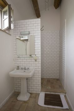 Simple but beautiful small bathroom. Love the hidden walk in shower. Great for the boys!