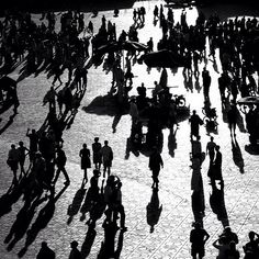 A rare #blackandwhite #photograph from our travels. It's the #JemmaElFna #square, #Marrakech, #Morocco.    #city #crowd #nightlife #sunset #plaza #people #humans #life #lifestyle #bw #TravelPhotography #TravelPic #street #shadows #silhouette    #Photo by #Travel+#Style. More: http://www.travelplusstyle.com/?s=Morocco