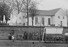"""St. John's Church, Richmond, Virginia, 1865. End of the Civil War. Wagoner poses with children and African American man in front of the site of Patrick Henry's famous """"Give Me Liberty or Give Me Death"""" speech. Library of Congress."""