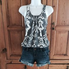 American Eagle Motif Print Tank American Eagle Motif Print Tank with string ties in back. 80% polyester 20% linen. Great summer tank with jean or white shorts. Worn Only a couple times. Like new condition. American Eagle Outfitters Tops Tank Tops