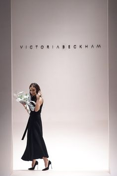 May 17 Victoria Beckham takes her bow on the catwalk following her fashion show in Singapore.