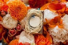 Orange florals. Wedding planning by Simply Wed. www.simplywed.com