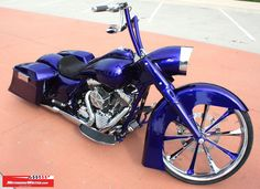 Slammed Harley Road King with a 23-inch front wheel.