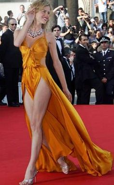 Eva Herzigova - Revealing and stunning gown on the red carpet but not really what you would wear to your school ball