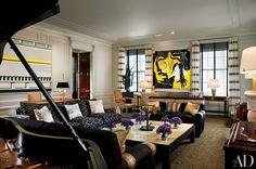 A striking contrast of black and yellow in the living room.