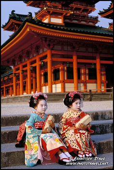 Photograph of Two little Maiko girls posing in front of Heian Jingu Shrine in Kyoto, Japan photos