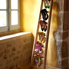 shoes as art. diy shoe storage/decor with a ladder and your prettiest heels.