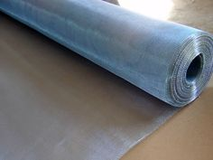 A roll of galvanized steel mesh screen with some unfolded part.