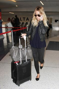 Lauren Conrad jet set style in flats, skinnies, and a moto jacket.