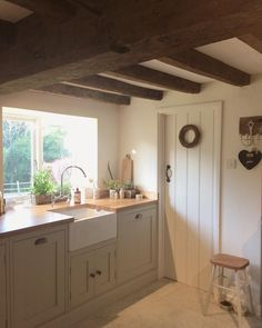 Putty Cabinets, Exposed Beams, Plaster Walls  French Country I Can Handle