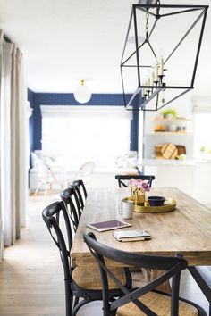 Crossback chairs at a wooden dining table in the kitchen