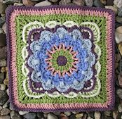 "This 12"" afghan square uses puff stitches and back post stitches to create an array of fan shapes. Bright contrasting colors make the fans appear to move and dance around each other. Or, try a single color to bring out the rich texture created by the post stitches."