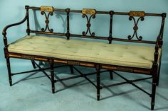 CIRCA 1820 ENGLISH REGENCY EBONIZED AND GILDED AND PAINTED SETTEE. Height: 35 in. by Width: 65 in. by Depth: 20 in.