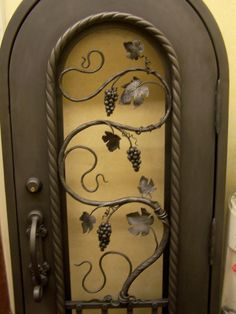 See Keuka Studios custom iron work performed in Rochester, New York. Wrought Iron Doors, Hidden Rooms, Wine Decor, Flowering Vines, Iron Work, Gate Design, Entry Doors, Metal Working, Decoration