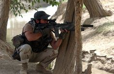 """Army Special Forces soldier nicknamed """"Porno"""" watches a suspicious person through his rifle scope during an operation August 2002 in the village of Daste Arche in Northern Afghanistan. Us Special Forces, Military Special Forces, Special Ops, Military Weapons, Military Life, Military History, Military Outfits, Military Guys, Delta Force"""
