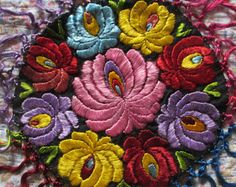 Traditional folk art vintage Hungarian Matyo silk floral embroidery small round table mat 1920s to 1940s