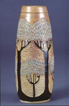 Wheel thrown stoneware vase, carved, underglazes, salt-fired by Russ Harris.