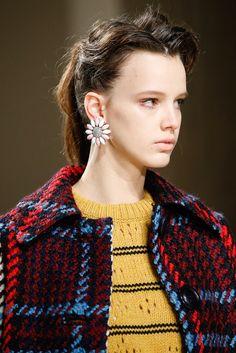 Vintage earrings  Miu Miu via Vogue