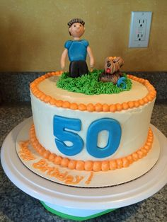 50th birthday cake for a man and man's best friend. Man and dog are made of rice crispy covered with fondant.
