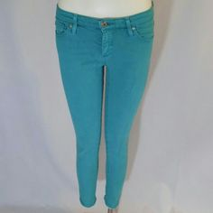 AG Adriano Goldschmied Teal Stevie Ankle Jeans Super stylish, trendy teal slim/skinny jeans by AG Adriano Goldschmied. Style name: the Stevie Ankle, Slim Straight Leg. Waistband with belt loops, zip fly with single button closure, 5 pockets, and a skinny/slim leg/silhouette. 55% cotton, 42% tencel, 3% PU. Made in the USA. Excellent condition with no noted flaws. No trades, no PP. AG Adriano Goldschmied Jeans