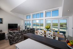 White contemporary open plan kitchen, living room and diner - with sea views of Porth Beach, Cornwall.