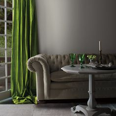Bright green curtain against neutral gray wall.
