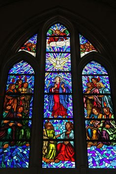 Religious scene on stained glass window of Almudena Cathedral  (Madrid)