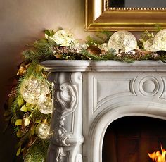 Magical, Festive Fairy Lights For Your Winter Wedding Decor ~ love these Northern Globe String Lights adorning the mantle via Restoration Hardware Christmas To Do List, Christmas Mood, Christmas Colors, Christmas Photos, Aqua Christmas, Christmas Treats, Christmas 2019, Green Christmas Lights, Gold Christmas Decorations