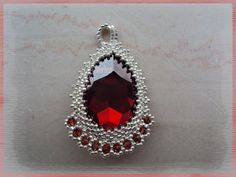 Another easy idea for an elegant bezel--just a picot edge on the top, with a netted edge at the bottom with embellishment.