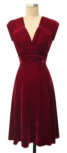 Early 40s, red velvet dress. Gorgeous.
