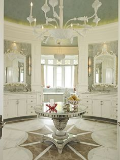 Reflective surfaces define this bathroom The mirrors over the sinks have shell and fish motifs A neoclassical starburst pattern in three colors of marble reinforces the room's geometry   Bath  Eclectic  TraditionalNeoclassical by Taylor & Taylor