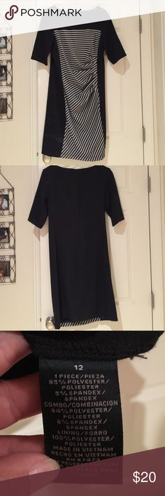 Dress Cinched on side. Very flattering. Small one in seam on back. Gabby skye Dresses Midi